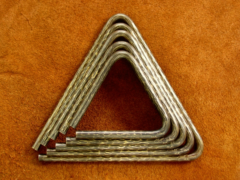 hand hammered triangles
